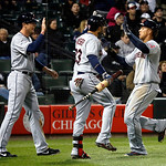 Cleveland Indians' Drew Stubbs, left, and Nick Swisher, center, greet Michael Brantley at home after Stubbs and Brantley scored on a single by Asdrubal Cabrera off a pitch by Chicago White S …