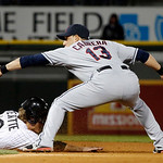 Cleveland Indians shortstop Asdrubal Cabrera (13) takes a throw from catcher Carlos Santana and picks off Chicago White Sox pinch runner Blake Tekotte during the seventh inning of a baseball …