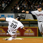 Cleveland Indians shortstop Asdrubal Cabrera, right, turns the double play forcing Chicago White Sox's Jordan Danks (20) at second and getting Alejandro De Aza at first during the seventh in …