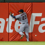Cleveland Indians left fielder Michael Brantley is unable to catch an RBI double by Chicago White Sox's Hector Gimenez, scoring Alexei Ramirez, during the fourth inning of a baseball game Mo …