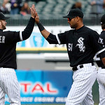 Chicago White Sox third baseman Jeff Keppinger (7) celebrates with right fielder Alex Rios (51) after their 3-2 win over the Cleveland Indians in a baseball game, Wednesday, April 24, 2013,  …