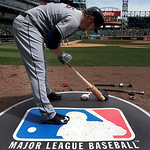 Cleveland Indians designated hitter Mark Reynolds stands on the Major League Baseball logo that serves as the on deck circle during the first inning of a baseball game between the Chicago Wh …