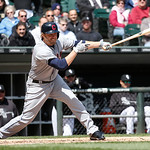 Cleveland Indians' Mark Reynolds hits a double during a baseball game against the Chicago White Sox Wednesday, April 24, 2013, in Chicago. (AP Photo/Charles Rex Arbogast)