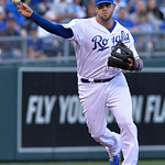 Kansas City Royals third baseman Mike Moustakas (8) throws to first for an out against the Cleveland Indiands in the first inning of their second baseball game, Sunday, April 28, 2013, in Ka …