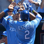 Kansas City Royals' Salvador Perez welcomes Kansas City Royals' Alcides Escobar (2) after a solo home run against the Cleveland Indians during the fifth inning of the first of two baseball g …