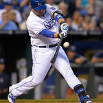 Kansas City Royals' Billy Butler hits this pitch for a double against the Cleveland Indians in the third inning of their second baseball game, Sunday, April 28, 2013, in Kansas City, Mo. (AP …