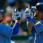 Kansas City Royals' Alex Gordon, right, celebrates his two-run home run with teammate Billy Butler during the eighth inning of the first of two baseball games against the Cleveland Indians,  …
