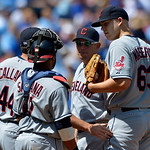 Cleveland Indians starting pitcher Justin Masterson (63) meets with pitching coach Mickey Callaway (44) and teammates during the fourth inning of the first baseball game of a doubleheader ag …