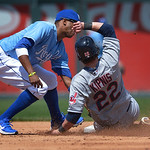 Kansas City Royals shortstop Alcides Escobar, left, tags out Cleveland Indians' Jason Kipnis (22) who was trying to steal second during the third inning of the first of two baseball games on …