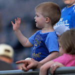 One of the Royals small fans waves to the players during warm-ups before a baseball game between the Kansas City Royals and Cleveland Indians, Monday, April 29, 2013, in Kansas City, Mo. (AP …
