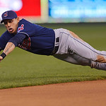 Cleveland Indians shortstop Asdrubal Cabrera makes a diving grab of this grounder off the bat of Kansas City Royals' Billy Butler, but can't make the out at first during the fourth inning of …