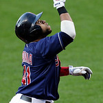 Cleveland Indians' Carlos Santana looks up as he runs the bases after hitting a two-run home run off Philadelphia Phillies starting pitcher Roy Halladay during the first inning of a baseball …