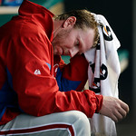 Philadelphia Phillies starting pitcher Roy Halladay wipes his head in the dugout in the fourth inning of a baseball game against the Cleveland Indians, Tuesday, April 30, 2013, in Cleveland. …