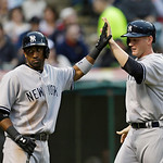 New York Yankees' Eduardo Nunez, left, and Lyle Overbay celebrate after scoring on a two-RBI-single by Brett Gardner in the second in the inning of a baseball game, Tuesday, April 9, 2013, i …