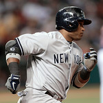 New York Yankees' Robinson Cano runs the bases after hitting a two-run home run off Cleveland Indians starting pitcher Carlos Carrasco in the fourth inning of a baseball game, Tuesday, April …