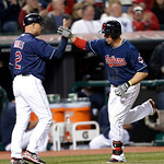 Cleveland Indians' Asdrubal Cabrera, right, is congratulated by third base coach Brad Mills after Cabrera hit a solo home run off New York Yankees starting pitcher Andy Pettitte in the sixth …