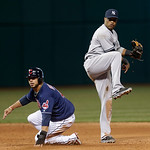 New York Yankees' Robinson Cano, right, and Cleveland Indians' Mike Aviles look toward first base in the ninth inning of a baseball game, Tuesday, April 9, 2013, in Cleveland. Aviles was out …