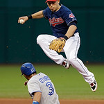 Cleveland Indians shortstop Asdrubal Cabrera avoids Toronto Blue Jays' Maicer Izturis after a force at second base in the fourth inning of a baseball game Tuesday, July 9, 2013, in Cleveland …