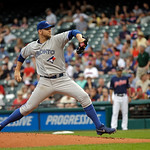 Toronto Blue Jays starting pitcher Josh Johnson delivers against the Cleveland Indians in the first inning of a baseball game Tuesday, July 9, 2013, in Cleveland. (AP Photo/Mark Duncan)
