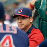 Cleveland Indians starting pitcher Scott Kazmir, center, watches from the dugout steps during the first inning of a baseball game against the Toronto Blue Jays Tuesday, July 9, 2013, in Clev …