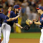 Cleveland Indians catcher Carlos Santana, left, relief pitcher Chris Perez, center, and shortstop Asdrubal Cabrera celebrate the Indians' 3-0 win over the Toronto Blue Jays in a baseball gam …
