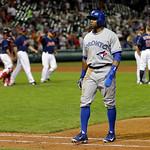 Toronto Blue Jays' Maicer Izturis walks off the field as the Cleveland Indians celebrate a 3-0 win in a baseball game Tuesday, July 9, 2013, in Cleveland. (AP Photo/Mark Duncan)