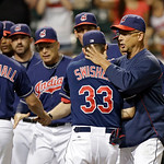Cleveland Indians manager Terry Francona, right, congratulates Nick Swisher (33) after a 3-0 win over the Toronto Blue Jays in a baseball game Tuesday, July 9, 2013, in Cleveland. (AP Photo/ …