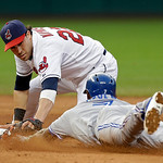 Cleveland Indians second baseman Jason Kipnis tags out Toronto Blue Jays' Jose Reyes, who was trying to stretch a hit into a double in the sixth inning of a baseball game Wednesday, July 10, …