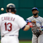 Toronto Blue Jays shortstop Jose Reyes, right, throws past Cleveland Indians' Asdrubal Cabrera to get Jason Kipnis at first in the fifth inning of a baseball game Wednesday, July 10, 2013, i …