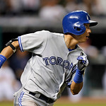 CORRECTS THAT TWO RUNS SCORED ON THE HIT, AND ONE ON AN ERROR – Toronto Blue Jays' Munenori Kawasaki runs to first on a bases-loaded single off Cleveland Indians relief pitcher Joe Smith to  …