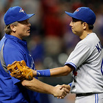Toronto Blue Jays manager John Gibbons, left, congratulates Munenori Kawasaki after Toronto's 5-4 win over the Cleveland Indians in a baseball game Wednesday, July 10, 2013, in Cleveland. (A …