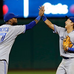 Toronto Blue Jays' Jose Reyes (7) celebrates with Munenori Kawasaki after Toronto's 5-4 win over the Cleveland Indians in a baseball game Wednesday, July 10, 2013, in Cleveland. Kawasaki's s …
