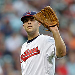 Cleveland Indians starting pitcher Justin Masterson gets the ball back from first baseman Nick Swisher in the fifth inning of a baseball game against the Toronto Blue Jays Wednesday, July 10 …