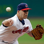 Cleveland Indians starting pitcher Justin Masterson delivers against the Toronto Blue Jays in the first inning of a baseball game Wednesday, July 10, 2013, in Cleveland. (AP Photo/Mark Dunca …