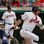 Cleveland Indians' Jason Giambi singles off Toronto Blue Jays relief pitcher Esmil Rogers to drive in a run in the second inning of a baseball game Wednesday, July 10, 2013, in Cleveland. (A …