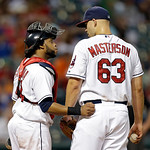Cleveland Indians catcher Carlos Santana tries to settle starting pitcher Justin Masterson in the seventh inning of a baseball game against the Toronto Blue Jays Wednesday, July 10, 2013, in …