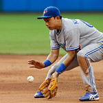 Toronto Blue Jays second baseman Munenori Kawasaki fields a ground ball by Cleveland Indians' Michael Brantley in the third inning of a baseball game Wednesday, July 10, 2013, in Cleveland.  …
