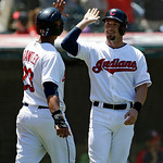 Cleveland Indians' Michael Brantley, left, and teammate Ryan Raburn celebrate after both scored in the sixth inning of a baseball game against the Toronto Blue Jays, Thursday, July 11, 2013, …