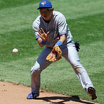 Toronto Blue Jays shortstop Munenori Kawasaki fields a ball hit by Cleveland Indians' Asdrubal Cabrera in the fifth inning of a baseball game, Thursday, July 11, 2013, in Cleveland. Cabrera  …