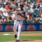 Cleveland Indians starting pitcher Danny Salazar throws to first base to try and get Toronto Blue Jays' Rajai Davis out in the third inning of a baseball game, Thursday, July 11, 2013, in Cl …
