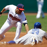 Cleveland Indians' Asdrubal Cabrera, left, is late on the tag as Toronto Blue Jays' Rajai Davis slides safely into second base for a steal in the third inning of a baseball game, Thursday, J …