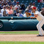 Cleveland Indians' Lonnie Chisenhall fields a ball hit by Kansas City Royals second baseman Johnny Giavotella in the eighth inning of a baseball game, Sunday, July 14, 2013, in Cleveland. Gi …