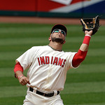 Cleveland Indians' Mike Aviles catches a fly ball hit by Kansas City Royals' Lorenzo Cain in the fifth inning of a baseball game, Sunday, July 14, 2013, in Cleveland. (AP Photo/Tony Dejak)