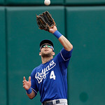 Kansas City Royals left fielder Alex Gordon catches a fly ball hit by Cleveland Indians' Nick Swisher in the first inning of a baseball game, Sunday, July 14, 2013, in Cleveland. Swisher was …