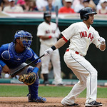 Cleveland Indians' Michael Brantley, right, watches his ball after hitting an RBI-single off Kansas City Royals starting pitcher James Shields in the third inning of a baseball game on Sunda …