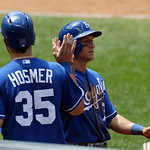 Kansas City Royals right fielder David Lough, right, is congratulated by Eric Hosmer after Lough scored in the fourth inning of a baseball game, Sunday, July 14, 2013, in Cleveland. Lough sc …