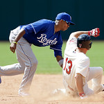 Kansas City Royals shortstop Alcides Escobar tags out Cleveland Indians' Asdrubal Cabrera at second base in the eighth inning of a baseball game, Sunday, July 14, 2013, in Cleveland. Cabrera …