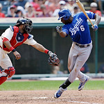 Kansas City Royals batter Lorenzo Cain, right, tries to avoid a tag by Cleveland Indians catcher Carlos Santana after Cain struck out in the seventh inning of a baseball game, Sunday, July 1 …