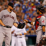 Cleveland Indians starting pitcher Corey Kluber, left, and catcher Carlos Santana, right, during a baseball game against the Kansas City Royals at Kauffman Stadium in Kansas City, Mo., Tuesd …