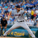 Cleveland Indians starting pitcher Corey Kluber (28) delivers to an Kansas City Royals batter during the first inning of a baseball game at Kauffman Stadium in Kansas City, Mo., Tuesday, Jul …